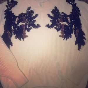 Knit sweater with sequin appliqué